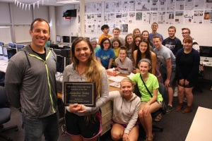 Prospector Managing Editor Aungelina Dahm, NINA's 2015 first-place scholarship winner, poses with Jason Block, faculty adviser to The Prospector, and the staff of Prospect High School's award-winning student newspaper.