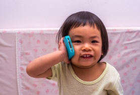 Toddler girl and cell phone